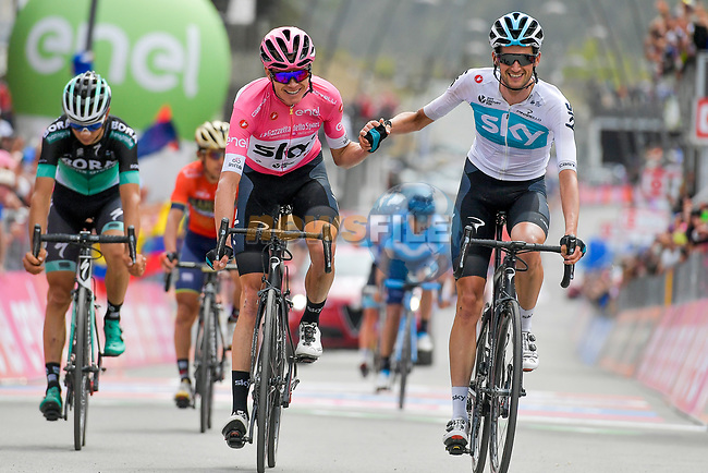 Job done race leader Chris Froome (GBR) and team mate Wout Poels (NED) Team Sky cross the finish line of Stage 20 of the 2018 Giro d'Italia, running 214km from Susa to Cervinia is the final mountain stage, with the last three climbs of Giro 101 deciding the GC of the Corsa Rosa, Italy. 26th May 2018.<br /> Picture: LaPresse/Marco Alpozzi | Cyclefile<br /> <br /> <br /> All photos usage must carry mandatory copyright credit (© Cyclefile | LaPresse/Marco Alpozzi)