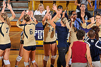 11 September 2011:  FIU's team (pictured, Sabrina Gonzalez (12), Renele Forde (14), Andrea Lakovic (1)) high-fives after winning the match.  The FIU Golden Panthers defeated the Florida A&M University Rattlers, 3-0 (25-10, 25-23, 26-24), at U.S Century Bank Arena in Miami, Florida.