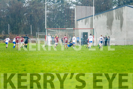 A penalty for Dromid and Christopher Ó Faircheallaigh makes no mistake as he drives the ball to the left sending St Marys keeper Mike Daly to the right.