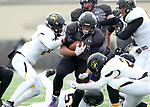 SIOUX FALLS, SD - NOVEMBER 10: Gabriel Watson #33 from the University of South Falls gang tackled by a host of defenders from Wayne State during their game Saturday afternoon at Bob Young Field in Sioux Falls. (Photo by Dave Eggen/Inertia)