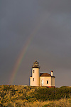 Coquille River Lighthouse and rainbow; Bandon, southern Oregon coast.