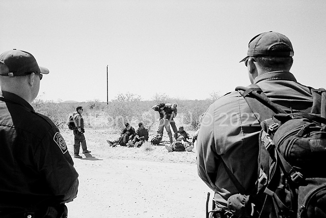Tohno O'odham Indian Reservation, Arizona<br /> May 5, 2008<br /> <br /> In the Tohno O'odham Indian Reservation along the US Mexican border, US Border patrol agents capture a group of illegal Mexican immigrants. Although new roads, fence and vehicle barrier have been put in place along the US/Mexcian border in Arizona illegal traffic is still very heavy in the Tucson sector.