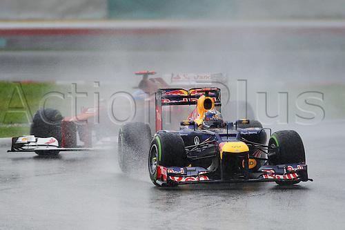 25.03.2012. Kuala Lumpur Malaysia. Formula 1 GP Malaysia in Kuala Lumpur Sebastian Vettel ger Red Bull Racing ahead of Fernando Alonso ESP Ferrari in the rainy conditions