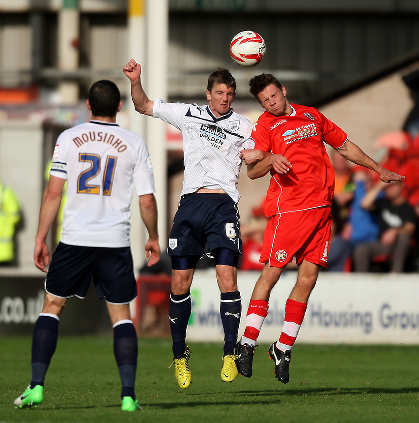 Preston North End's Shane Cansdell-Sherriff  jumps with Ben Purkiss.Football - npower Football League Division One - Walsall v Preston North End - Saturday 22nd September 2012 - Banks's Stadium - Walsall..