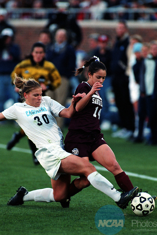 9 DEC 2001: Bree Horvath (14) of Santa Clara University battles Danielle Borgman (30) of the University of North Carolina-Chapel Hill for possesion of the ball during the NCAA Women's Division 1 Soccer Championships held at Gerald J. Ford Stadium on the campus of Southern Methodist University in Dallas, TX.  Santa Clara University defeated the University of Carolina-Chapel Hill 1-0 to win the national title.  Alison Woodworth/NCAA Photos