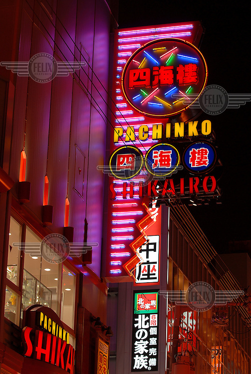 Neon lights along the streets of the popular Dotonbori nightlife and shopping district.