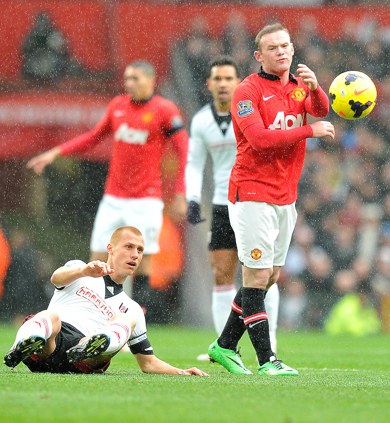 Manchester United's Wayne Rooney shows his frustration after being penalised for a foul on Fulham's Steve Sidwell (grounded)<br /> <br /> Photo by Dave Howarth/CameraSport<br /> <br /> Football - Barclays Premiership - Manchester United v Fulham - Sunday 9th February 2014 - Old Trafford - Manchester<br /> <br /> &copy; CameraSport - 43 Linden Ave. Countesthorpe. Leicester. England. LE8 5PG - Tel: +44 (0) 116 277 4147 - admin@camerasport.com - www.camerasport.com