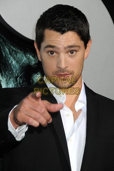 "NICHOLAS D'AGOSTO.""Final Destination 5"" Los Angeles Special Screening held at Grauman's Chinese Theatre, Hollywood, California, USA..August 10th, 2011.headshot portrait black white stubble facial hair hand finger pointing .CAP/ADM/BP.©Byron Purvis/AdMedia/Capital Pictures."