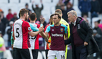 Mark Noble of West Ham United & West Ham United Manager David Moyes at full time during the EPL - Premier League match between West Ham United and Southampton at the Olympic Park, London, England on 31 March 2018. Photo by Andy Rowland.