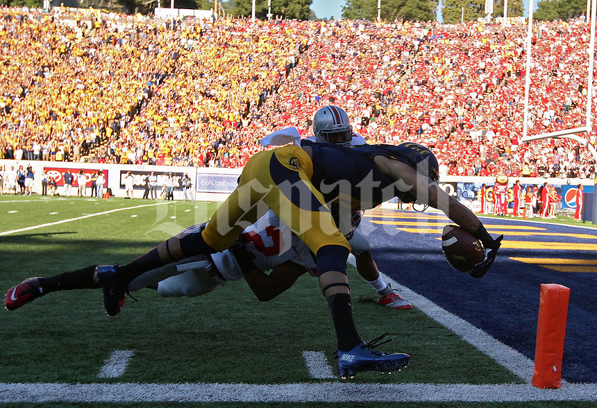 California Golden Bears wide receiver Chris Harper (6) carries the ball up field for a touchdown after a catch against Ohio State Buckeyes safety Christian Bryant (2) tries to tackle him in the 1st quarter at Memorial Stadium in Berkeley, California on September 14, 2013.  (Dispatch photo by Kyle Robertson)