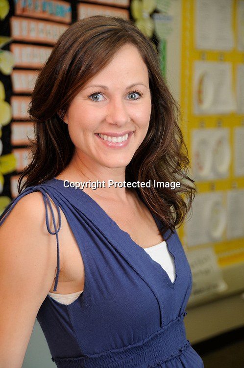 Stock photo of female school teacher in classroom