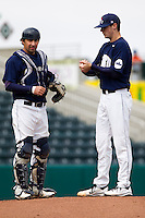Bryce Smolen (44) of the Oral Roberts Golden Eagles has a conversation with catcher Brett Burch (20) during a game against the Missouri State Bears on March 27, 2011 at Hammons Field in Springfield, Missouri.  Photo By David Welker/Four Seam Images