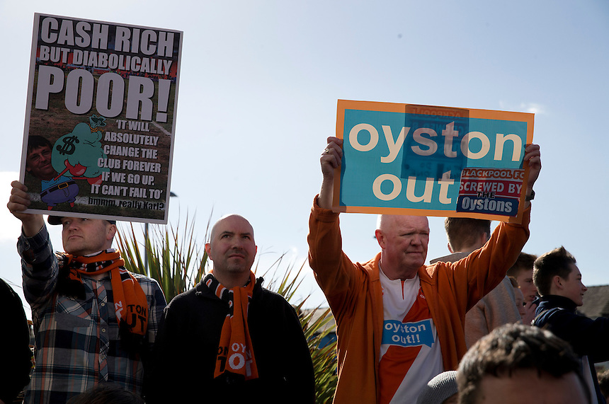 Blackpool fans protest outside Bloomfield Road against the owner Owen John Oyston and the way the club is being run<br /> <br /> Photographer Stephen White/CameraSport<br /> <br /> Football - The Football League Sky Bet Championship - Blackpool v Leeds United - Saturday 21st March 2015 - Bloomfield Road - Blackpool<br /> <br /> &copy; CameraSport - 43 Linden Ave. Countesthorpe. Leicester. England. LE8 5PG - Tel: +44 (0) 116 277 4147 - admin@camerasport.com - www.camerasport.com