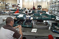 22 LUG 2004 Bollate: il carcere milanese di Bollate. Impianto di riciclaggio per rifiuti elettronici.JUL 22 2004 The prison of Bollate near Milan. Plant for the recycling of electronic material ..