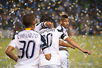CARSON, CA – September 9, 2011: LA Galaxy players Paolo Cardozo (30), Landon Donovan (10) and Sean Franklin (5) celebrate Donovan's goal during the match between LA Galaxy and Colorado Rapids at the Home Depot Center in Carson, California. Final score LA Galaxy 1, Colorado Rapids 0.