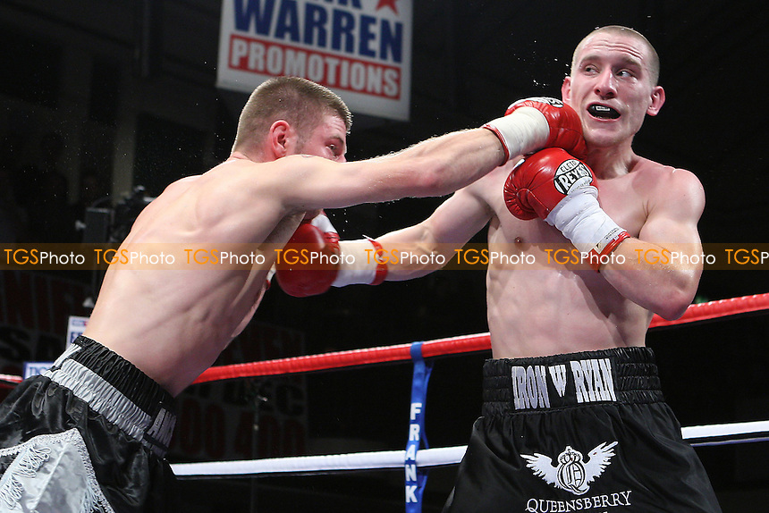 Ryan Walsh (black shorts) defeats James Ancliff in a Super-Bantamweight boxing contest at York Hall, Bethnal Green, promoted by Frank Warren - 23/10/10 - MANDATORY CREDIT: Gavin Ellis/TGSPHOTO - Self billing applies where appropriate - Tel: 0845 094 6026