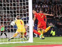 Jordan Rhodes bravely goes in on goalkeeper Martin Bogatinov in the Scotland v Macedonia FIFA World Cup Qualifying match at Hampden Park, Glasgow on 11.9.12.