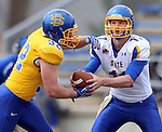 BROOKINGS, SD - APRIL 26:  Kyle Paris #32 from South Dakota State's offense takes the hand off from quarterback Tyler Finnes #11 during their spring game Saturday at Coughlin Alumni Stadium in Brookings. (Photo by Dave Eggen/Inertia)