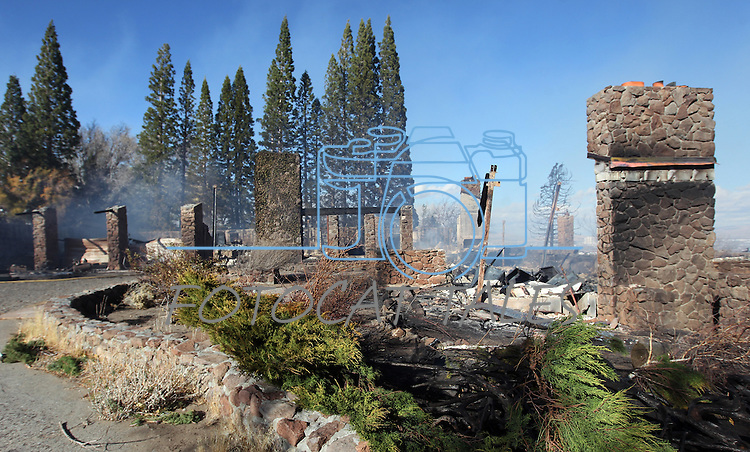 A home on Windy Hill in south Reno, Nev., was one of at least 25 homes destroyed by a 2,000-acre brush fire Nov. 18, 2011. More than 25 homes have been lost as high winds with gusts up to 60 mph drive the flames. (AP Photo/Cathleen Allison)