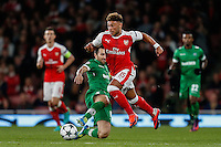 Alex Oxlade-Chamberlain of Arsenal (right) avoids the challenge from Svetoslav Dyakov of Ludogorets Razgrad (left) during the UEFA Champions League match between Arsenal and PFC Ludogorets Razgrad at the Emirates Stadium, London, England on 19 October 2016. Photo by David Horn / PRiME Media Images.
