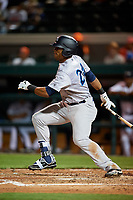 Tampa Tarpons right fielder Isiah Gilliam (24) follows through on a swing during a game against the Lakeland Flying Tigers on April 5, 2018 at Publix Field at Joker Marchant Stadium in Lakeland, Florida.  Tampa defeated Lakeland 4-2.  (Mike Janes/Four Seam Images)