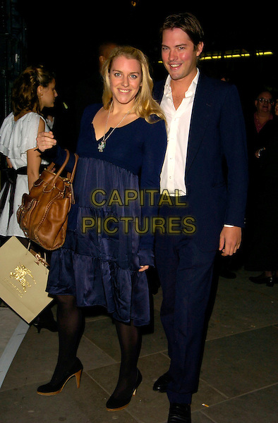 LAURA PARKER BOWLES & HARRY LOPES.The VIP private viewing of portraits by artist David Hockney at the National Portrait Gallery, London, UK..October 11th, 2006 .Ref: CAN.full length blue dress suit brown large big bag purse.www.capitalpictures.com.sales@capitalpictures.com.©Can Nguyen/Capital Pictures.
