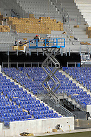 Workers installing the seats in Red Bull Arena after a press conference at Red Bull Arena in Harrison, NJ, on January 13, 2010.