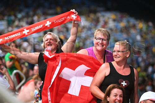 05.08.2016. Rio de Janeiro, Brazil.  Spectators wave a Swiss flag during the opening ceremony of the Rio 2016 Olympic Games at the Maracana stadium in Rio de Janeiro, Brazil, 5th August 2016.