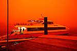 Apocalyptic vision of Sydney, shrouded in red dust blown in by winds from the deserts of the outback..Sydneysiders woke to a red dawn this morning as a thick dust storm caused havoc with transport and raised health fears..The size of the dust cloud surprised weather experts, who say it has covered half of NSW.