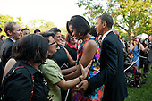 United States President Barack Obama and First Lady Michelle Obama greet guests at the Cinco de Mayo reception in the Rose Garden of the White House, Wednesday, May 5, 2010..Mandatory Credit: Pete Souza - White House via CNP