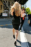 USA, California, San Francisco, a blonde woman walks the streets of North Beach in a black dress