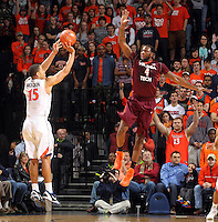 Virginia guard Malcolm Brogdon (15) shoots a 3-point basket over Virginia Tech forward Cadarian Raines (4) during the game Saturday in Charlottesville, VA. Photo/The Daily Progress/Andrew Shurtleff