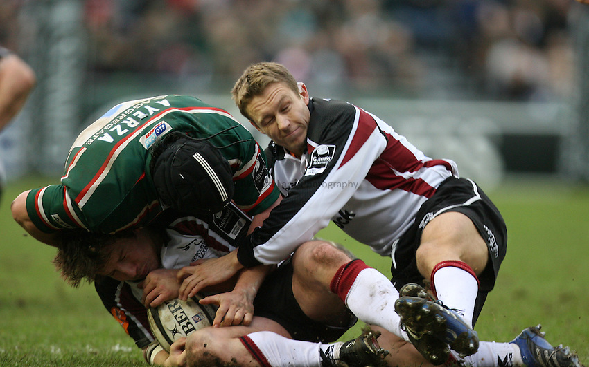 Photo: Rich Eaton...Leicester Tigers v Newcastle Falcons. Guinness Premiership. 27/01/2007. Jonny Wilkinson of Newcastle Falcons right makes an impact within a few seconds of coming on late in the first half tackling Marcos Ayerza.