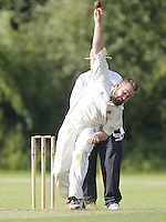Mike Cunnachie bowls for Shepherds Bush during the Middlesex County Cricket League Division Two game between Harrow St Mary's and Shepherds Bush at<br /> Harrow on Sat July 19, 2014