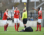 the referee doles out a yellow card to Stephen kelly of Newmarket to the protests of team mates Colin Ryan and Tino Nzvaura during their Munster Junior Cup semi-final at Limerick. Photograph by John Kelly.