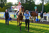 Winner of The Derek Burridge Golf & Racing Trophies Handicap Twenty Years On ridden by Finley Marsh and trained by Richard Hughes  is led into the Winners enclosure during Evening Racing at Salisbury Racecourse on 25th May 2019
