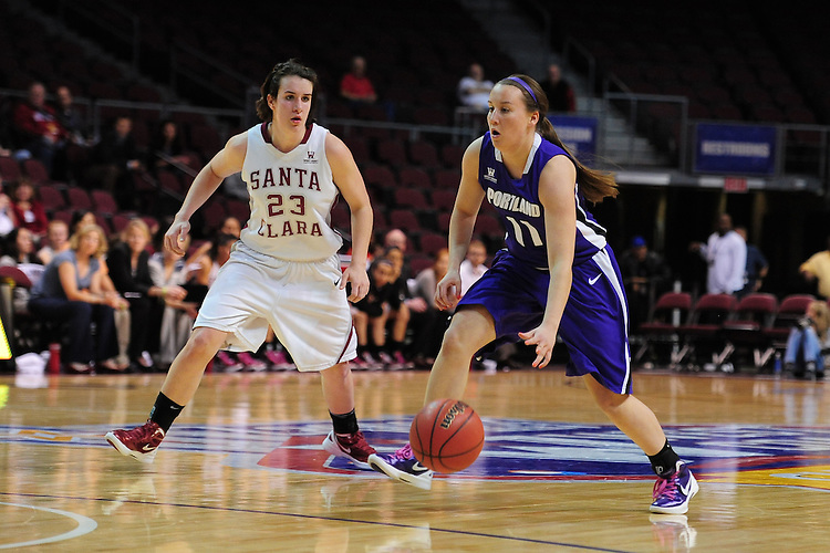 March 1, 2012; Las Vegas, NV, USA; Portland Pilots guard Colleen Olinger (11) dribbles the ball against Santa Clara Broncos guard Ashley Armstrong (23) during the WCC Basketball Championships at Orleans Arena.