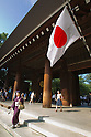 August 15, 2011 - Tokyo, Japan - A Japanese woman dressed in a traditional costume walks down the steps at Yasukuni Shrine. Thousands of people visit this shrine to pay their respect to the Japanese war soldiers who died fighting in World War II which marks the 66th anniversary of the end of WWII. (Photo by Christopher Jue/AFLO)