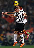 Calcio, quarti di finale di Coppa Italia: Roma vs Juventus. Roma, stadio Olimpico, 21 gennaio 2014.<br /> Juventus midfielder Mauricio Isla, of Chile, foreground, and AS Roma defender Vasilis Torosidis, of Greece,  jump for the ball during the Italian Cup round of eight final football match between AS Roma and Juventus, at Rome's Olympic stadium, 21 January 2014.<br /> UPDATE IMAGES PRESS/Riccardo De Luca