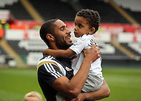SWANSEA, WALES - MAY 17: Ashley Williams of Swansea with his son after the Premier League match between Swansea City and Manchester City at The Liberty Stadium on May 17, 2015 in Swansea, Wales. (photo by Athena Pictures/Getty Images)