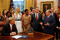 "United States Senator Chris Coons (Democrat of Delaware) makes remarks prior to US President Donald J. Trump signing the National Security Presidential Memorandum to Launch the ""Women's Global Development and Prosperity"" Initiative in the Oval Office of the White House in Washington, DC on Thursday, February 7, 2019.  Standing at left center listening to Senator Coons is First Daughter and Advisor to the President Ivanka Trump.<br /> Credit: Martin H. Simon / CNP/AdMedia"