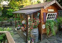 Garden tool shed with porch decorated with recycled flea market style