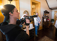 NWA Democrat-Gazette/BEN GOFF @NWABENGOFF<br /> Evan Keith (left), an Arkansas Arts Academy student, films Friday, March 2, 2018, as students from Arkansas Arts Academy film for a project at the Peel Mansion Museum and Heritage Gardens in Bentonville. High school students from the school's audio visual class and theater program are collaborating to produce a 15 minute short film about the Peel Mansion as an entry for the Arkansas Educational Television Network's Student Selects competition for young filmmakers. The film includes interviews with people involved in the museum as well as vignettes of moments in the 1875 home's history with theater students portraying historical figures.