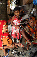 Women and children sift through used electronics in a small village near Kolkata.<br /> <br /> To license this image, please contact the National Geographic Creative Collection:<br /> <br /> Image ID: 1925795 <br />  <br /> Email: natgeocreative@ngs.org<br /> <br /> Telephone: 202 857 7537 / Toll Free 800 434 2244<br /> <br /> National Geographic Creative<br /> 1145 17th St NW, Washington DC 20036