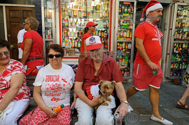 Residents dressed in the red and white of the Gibraltan flag during celebrations on Gibraltar National Day.