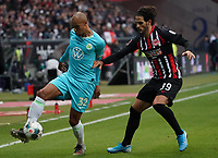 Marcel Tisserand (VfL Wolfsburg) gegen Goncalo Paciencia (Eintracht Frankfurt) - 23.11.2019: Eintracht Frankfurt vs. VfL Wolfsburg, Commerzbank Arena, 12. Spieltag<br /> DISCLAIMER: DFL regulations prohibit any use of photographs as image sequences and/or quasi-video.