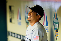 Anthony Rendon #23 of the Rice Owls has a laugh in the visitors dugout prior to the game against the Baylor Bears at Minute Maid Park on March 6, 2011 in Houston, Texas.  Photo by Brian Westerholt / Four Seam Images