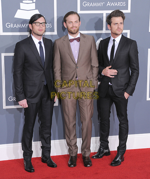 Kings of Leon - Nathan Followill, Caleb Followill & Jared Followill.The 54th Annual GRAMMY Awards held at the Staples Center, Los Angeles, California, USA..February 12th, 2012.full length black brown beige suit glasses hands in pockets band group .CAP/RKE/DVS.©DVS/RockinExposures/Capital Pictures.