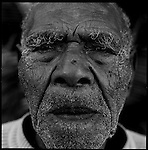 Fiji.  A village elder 99 years old in the Yasawa chain of islands is the oldest in the village. Fiji. Fiji is a popular diving and snorkeling destination. However Fiji's coral reefs are faced by land pollution, overfishing, blast fishing and bleaching. Because of an increase in sea temperatures the coral turns white and eventually dies. Coral bleaching is a result of global warming. Here a local villager on the southern shores of Viti Levu scours the coastline for octupus and other marine creatures useful in everyday life.