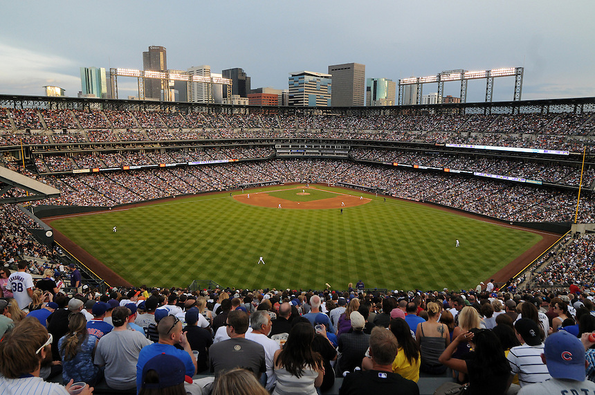 """31 JULY 2010: A general view of Coors Field from the outfield bleacher seats, the """"Rockpile"""" during an evening game with Denver skyscrapers in the background during a regular season Major League Baseball game between the Colorado Rockies and the Chicago Cubs at Coors Field in Denver, Colorado.   *****For Editorial Use Only*****"""